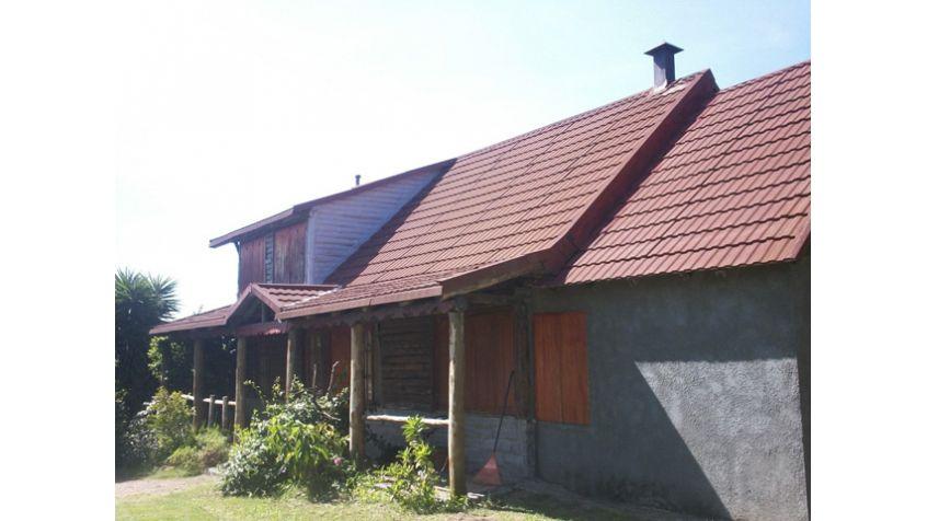 Imagen 3 Chacra con dos  casas en  rústico.